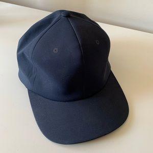 Herschel navy baseball cap with buckle strap EUC